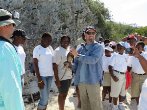 Dr. Knapp speaking to a school group about Shedd's iguana conservation program.